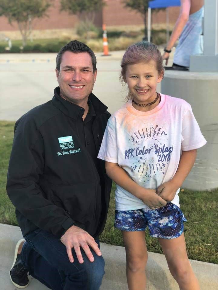 Dr. Bietsch with child from the fun run